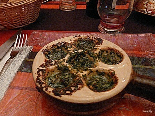 Dinner in France - snails baked in a garlic sauce