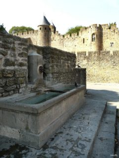 Waterhole in front of the entrance to the fortifications of Carcassonne