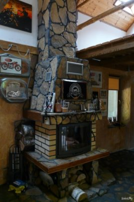 Stylish fireplace inside the motorcycle home