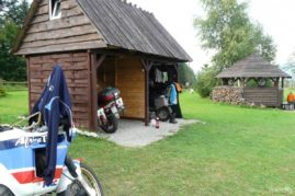 Wooden shelters for motorcyclists are a dry space under the roof for the driver and his steed
